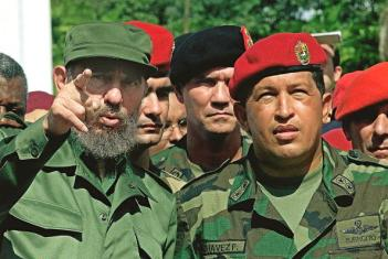 VALENCIA, VENEZUELA: Cuban President Fidel Castro (L) talks with Venezuelan President Hugo Chavez (R) during their visit the unknown soldier monument in Campo Carabobo, Valencia, Venezuela, 29 October 2000. Castro is on 5-day official visit to Venezuela. El presidente cubano Fidel Castro (I) conversa con el presidente de Venezuela Hugo Chavez (D) durante la visita que ambos realizaron al monumento al soldado desconocido en Campo Carabobo, Valencia, Venezuela, el 29 de octubre de 2000. Castro realiza una visita oficial de 5 dias a Venezuela donde ha visitado lugares historicos, sociales y deportivos acompanado de Chavez. AFP PHOTO / Adalberto ROQUE (Photo credit should read ADALBERTO ROQUE/AFP/Getty Images)